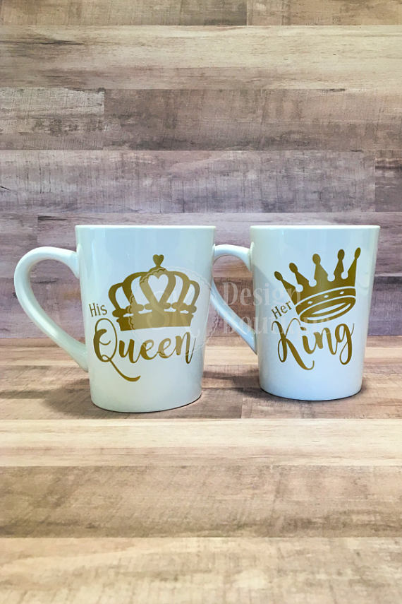 His Queen Her King Matching Set Of 2 Coffee Mugs For The Each Mug Is White Stoneware With A 14 Oz Capacity Font Color Shown Gold Metallic