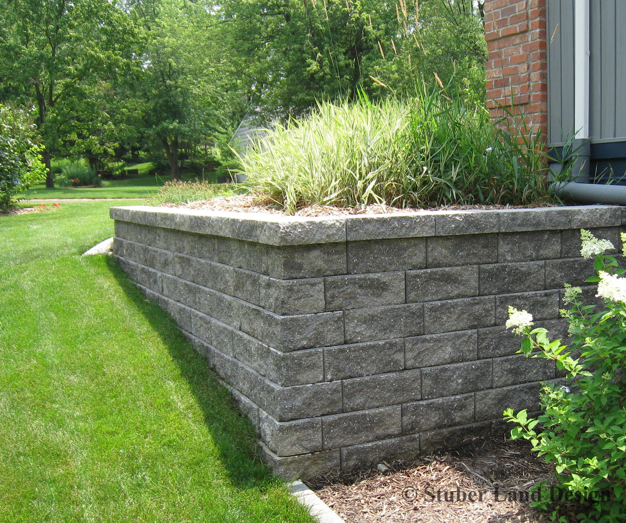 Landscape wall constructed using versa lok retaining wall for Garden wall idea