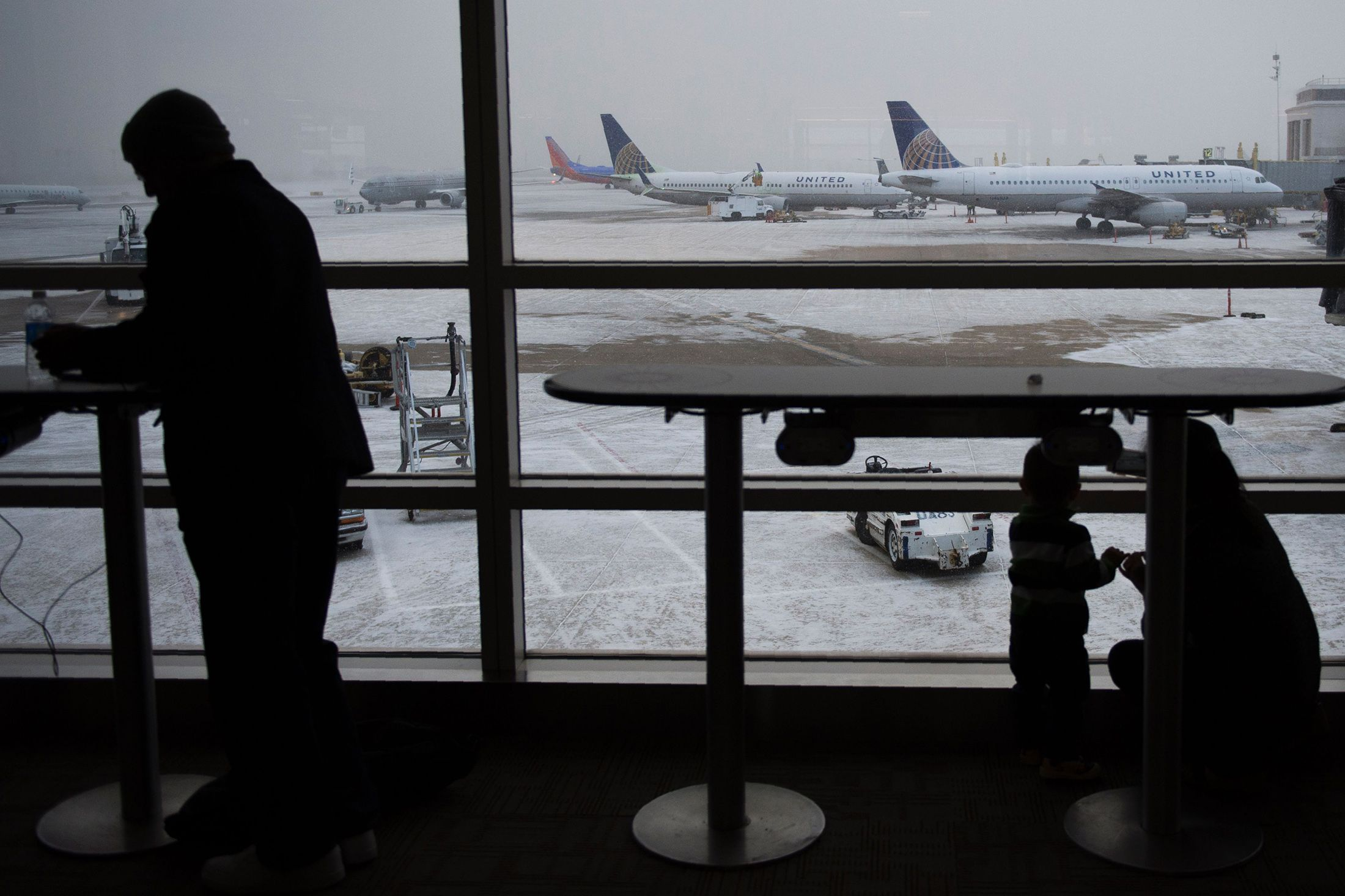 Icy Weather Snarls Holiday Travel for Thousands of U.S