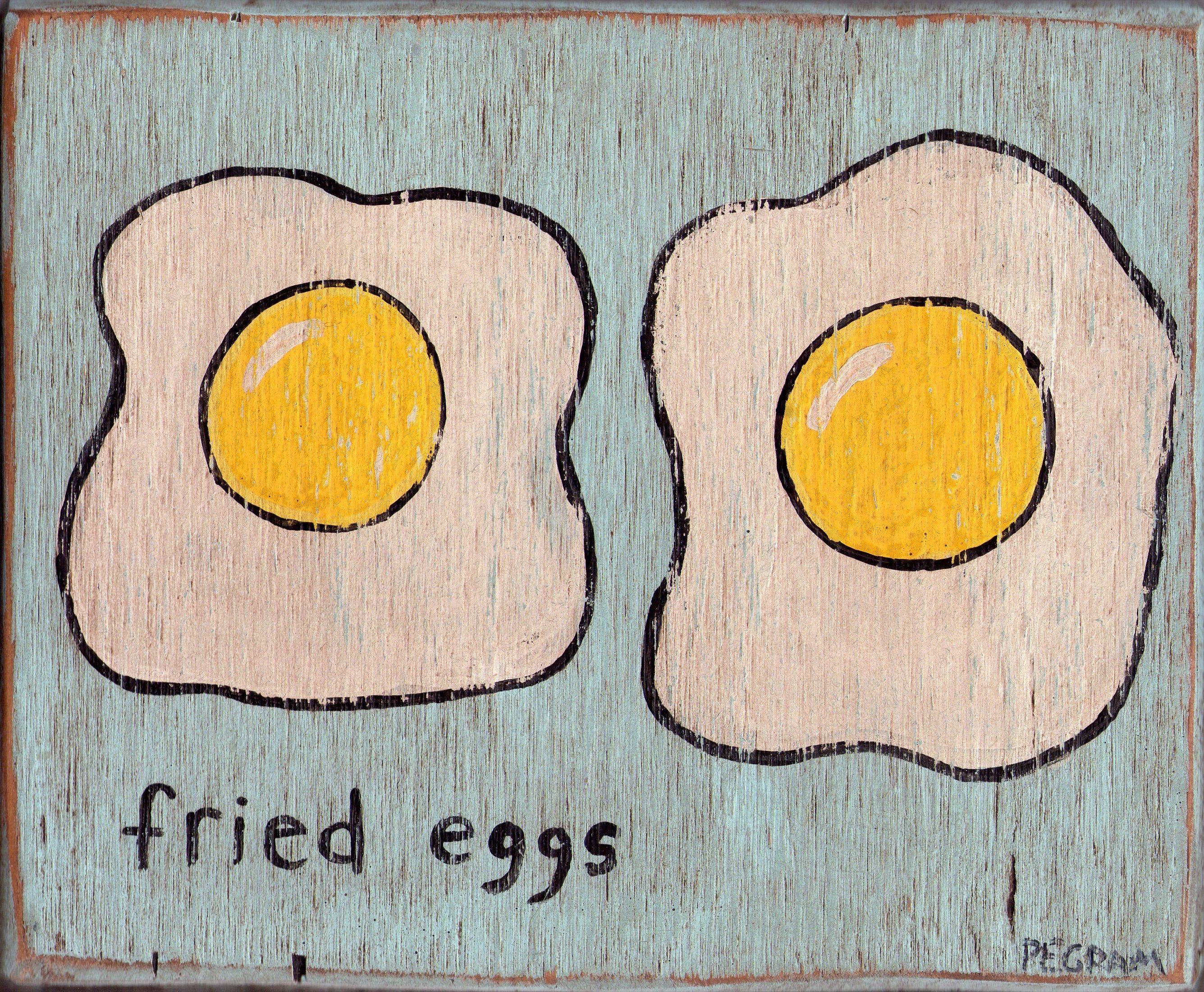 fried eggs on wood
