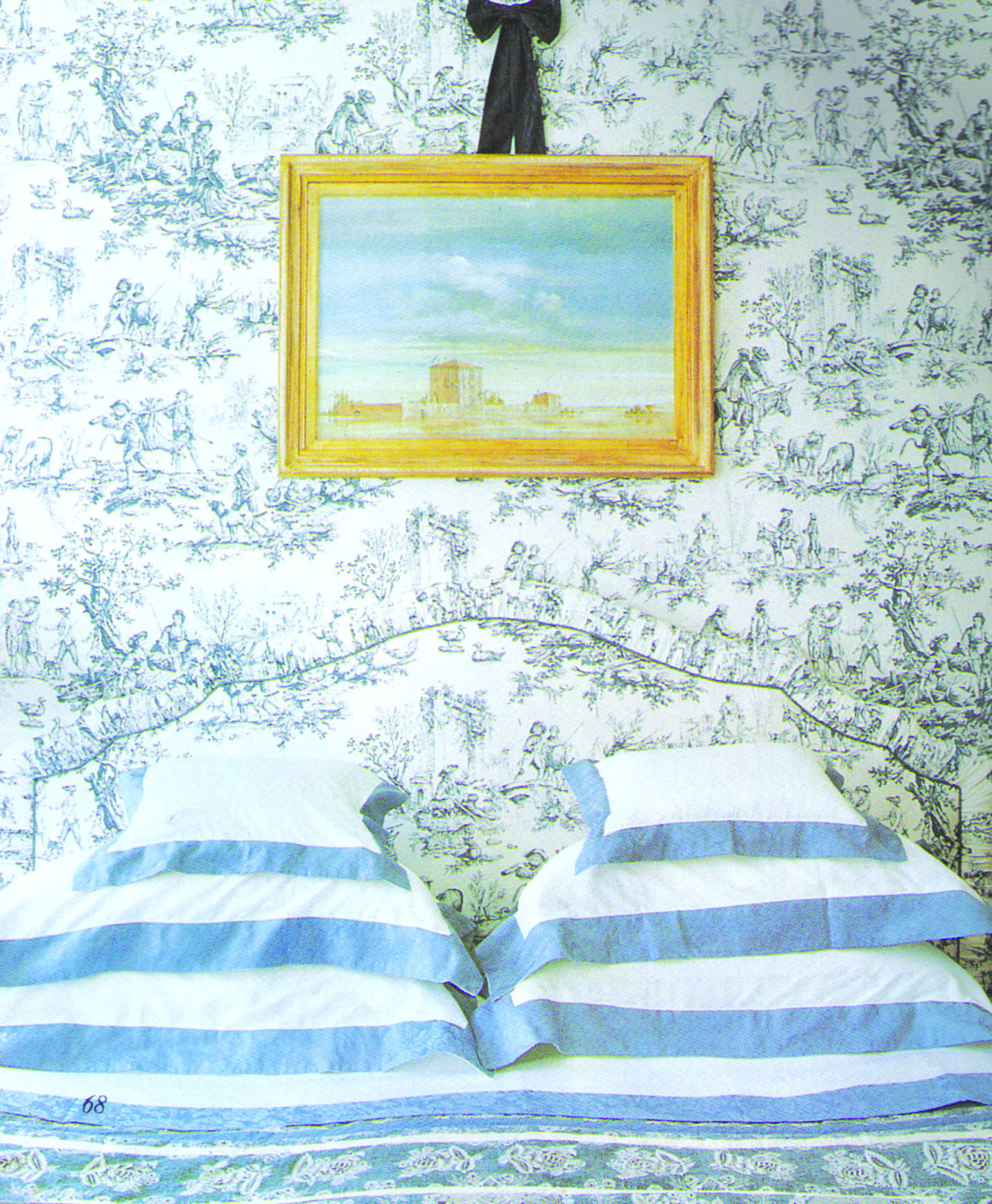 Blue toile wallpaper, gilded frame and blue-banded linens: Victoria magazine, June 1999