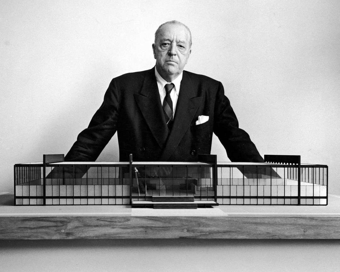Mies van der Rohe stands with a scale model for Crown Hall in Chicago.