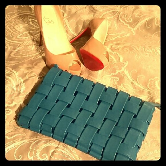 Woven Teal Clutch Great as clutch or put gold chain on to wear as a cute ourse. Great condition, inside is clean with no damage, and the only wear is at the bottom of the bag as pictured. Bags Clutches & Wristlets