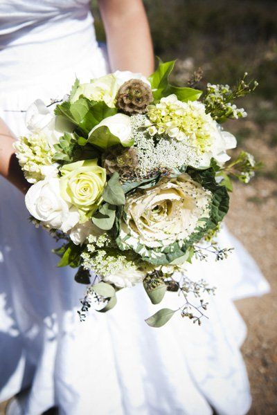 Shades of white combined with loose greenery reflect the more laid-back vibe of a rustic wedding.