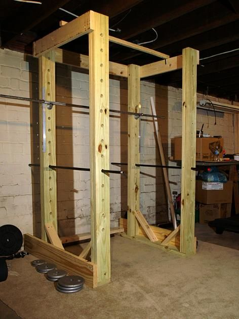 Homemade power rack made out of wood and pipe homemade gym