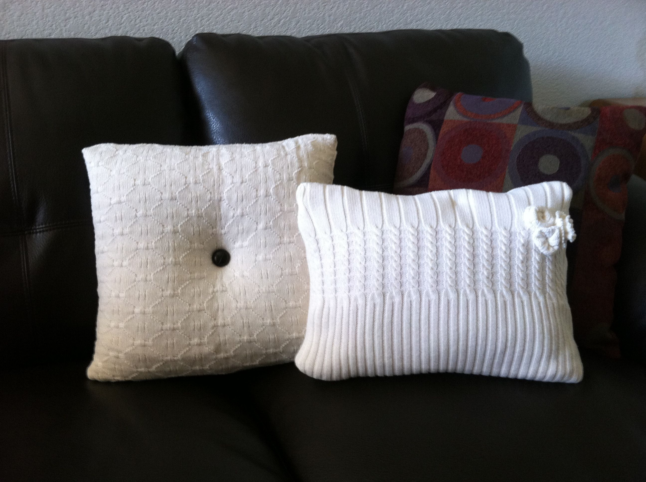 My version of sweater pillows.  Sweaters were purchased from Goodwill for $3 each.