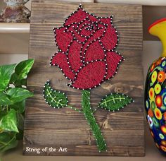 "String Art DIY Kit, Rose String Art, Flower String Art. Save 10% of the purchase price of this Rose String Art Kit by using the coupon code ""PinLove"" at String of the Art's Etsy shop.  Red Rose String Art"