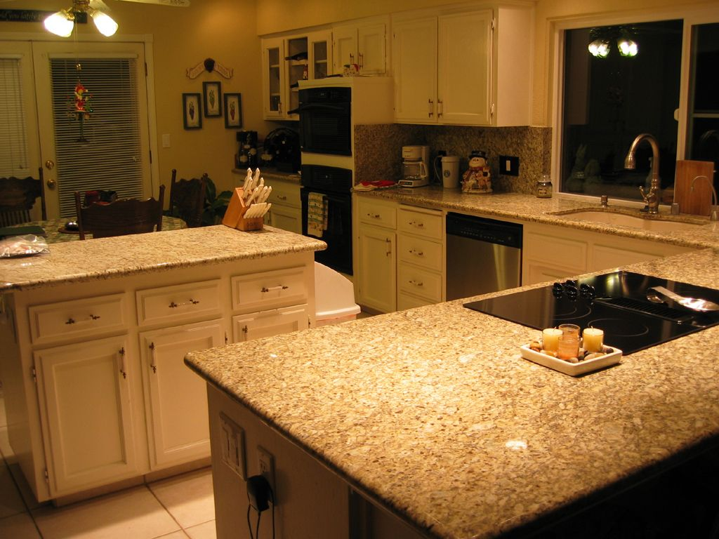 Photos of granite kitchen tops new venetian gold granite for Pictures of white kitchen cabinets with granite countertops