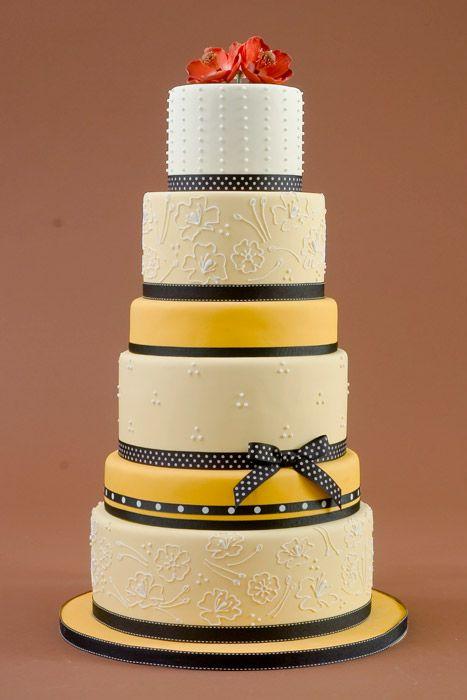 Amazing yellow, black and white wedding cake by Charm City Cakes ...