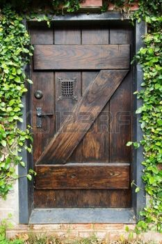 Small Spanish Style Dark Stained Wood Door To Secret Garden With