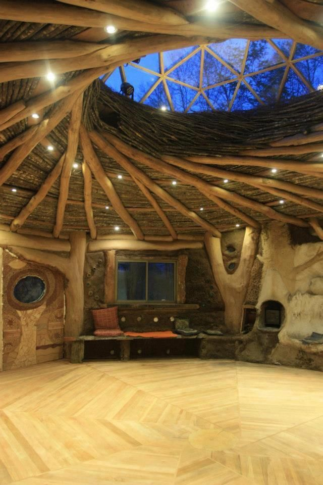 Visual candy rom the La Bioguia FB page: roundwood structure, cob, stone and natural wooden beams, reciprocal roof, round clear ceiling, very natural, very beautiful. Those walls could be cobwood or any other natural, sustainable style. www.cordwoodconstruction.org