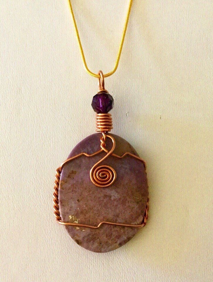 A personal favorite from my Etsy shop https://www.etsy.com/listing/255230315/copper-wrapped-brownish-pink-oval-large