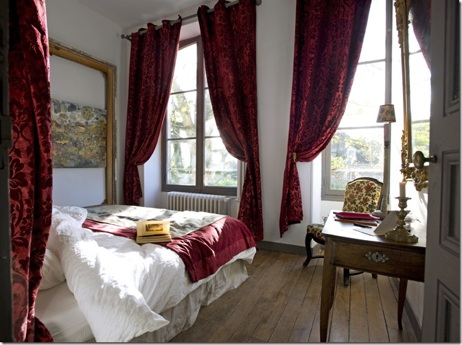 The Red Velvet Curtains Mixed With The White Bedding And Simple