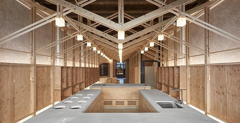 a free-standing structure made of japanese cypress has been constructed inside this grocery store which also serves as the owner's home.