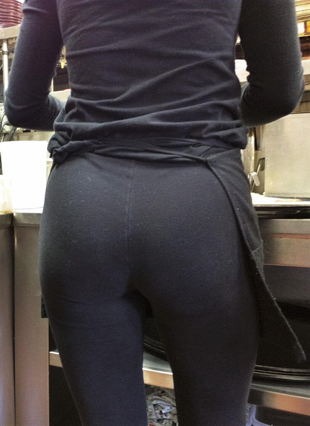 hot waitress with a very sexy ass wearing black yoga pants at work