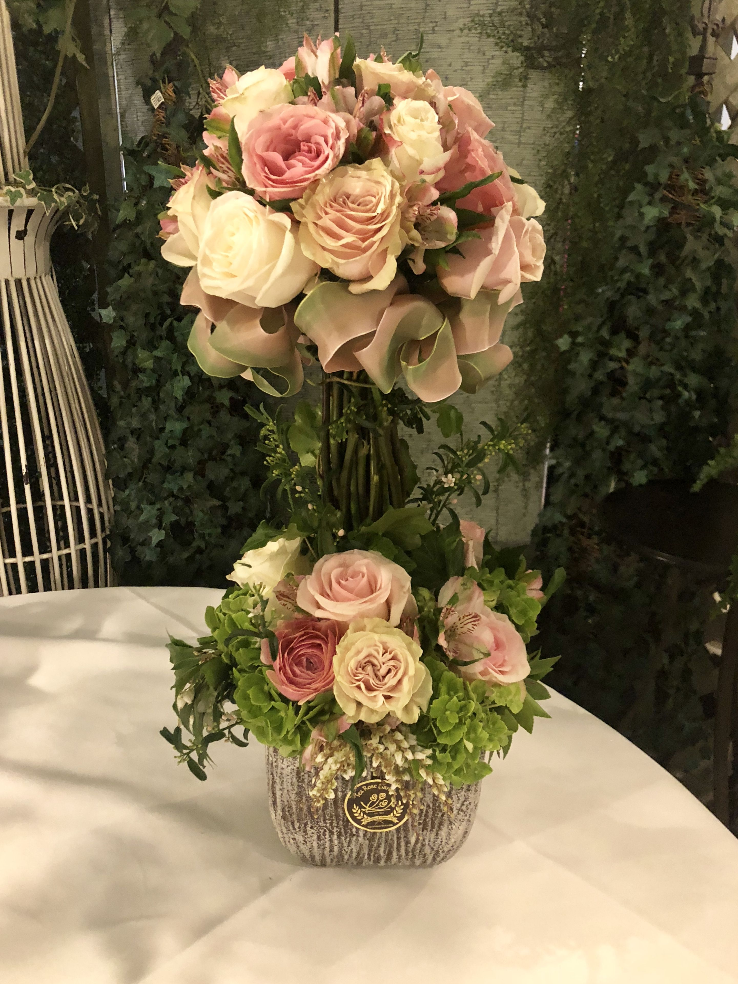 A Tea Rose Gardem signature topiary in blushes and pastels. #topiary ...