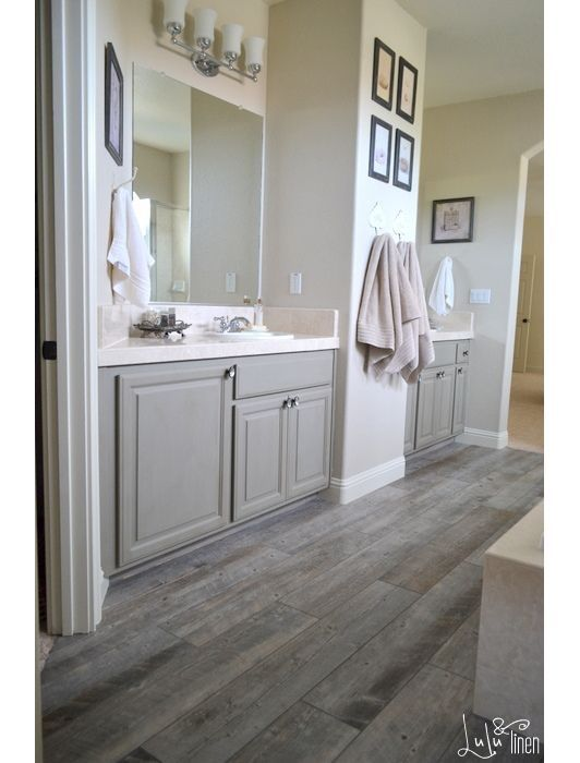 dark gray weathered wooden floors in rustic bathroom