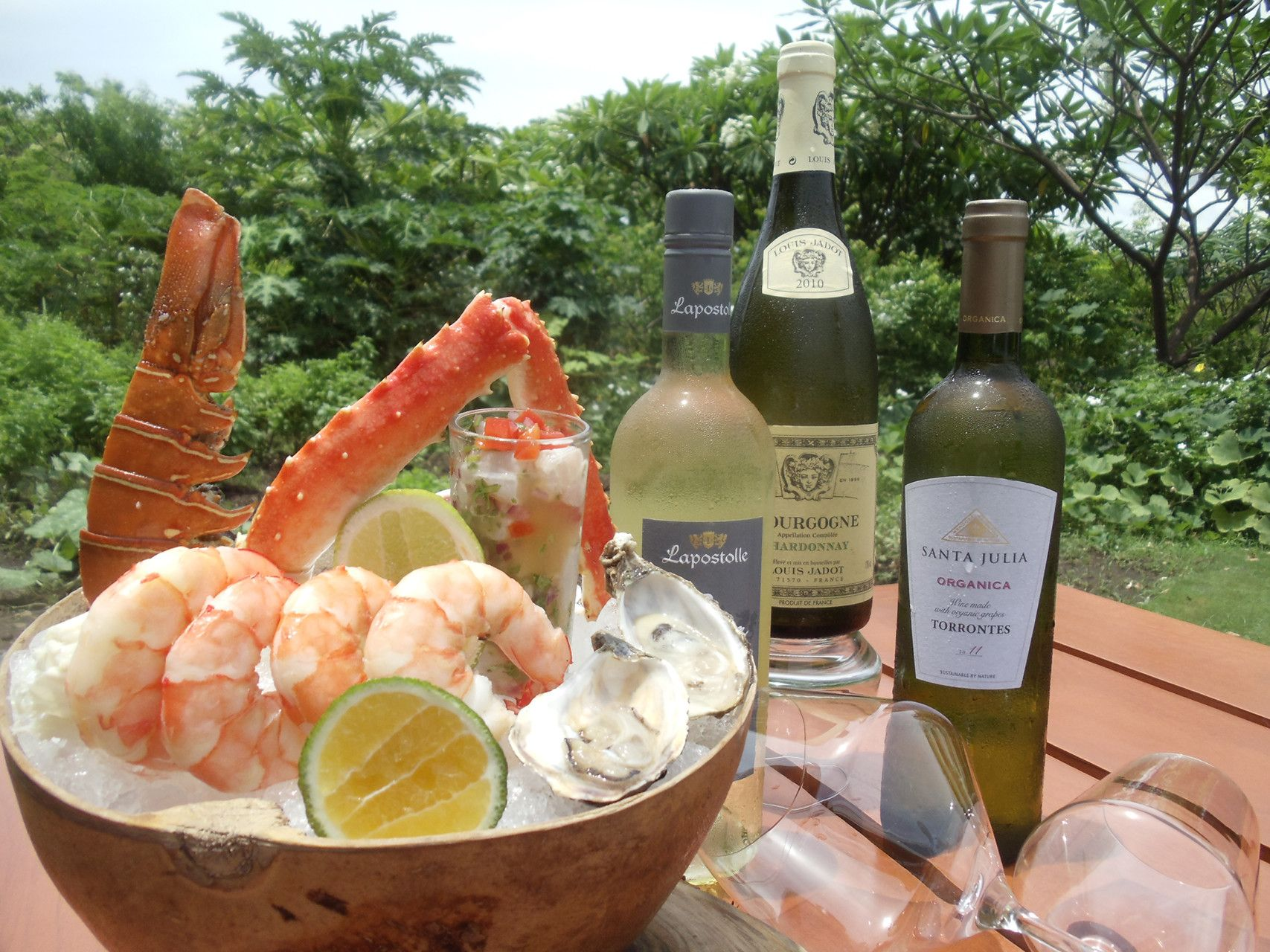 New organic and biodynamic white wines at Caracol restaurant at Four Seasons Costa Rica paired with seafood platter including local oysters, ceviche, jumbo prawns, lobster tail and crab legs.