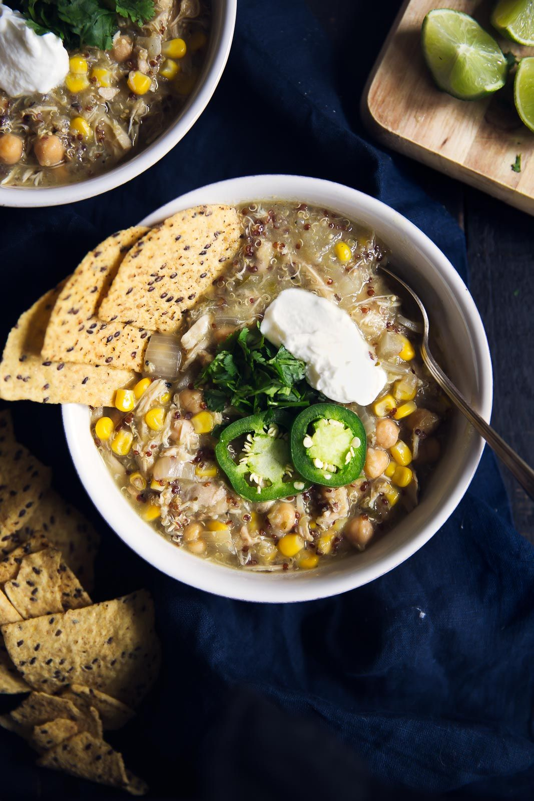 Healthy slow cooker salsa verde chicken chickpea chili with quinoa & lots of lime flavor. Serve with tortilla chips, avocado & greek yogurt!