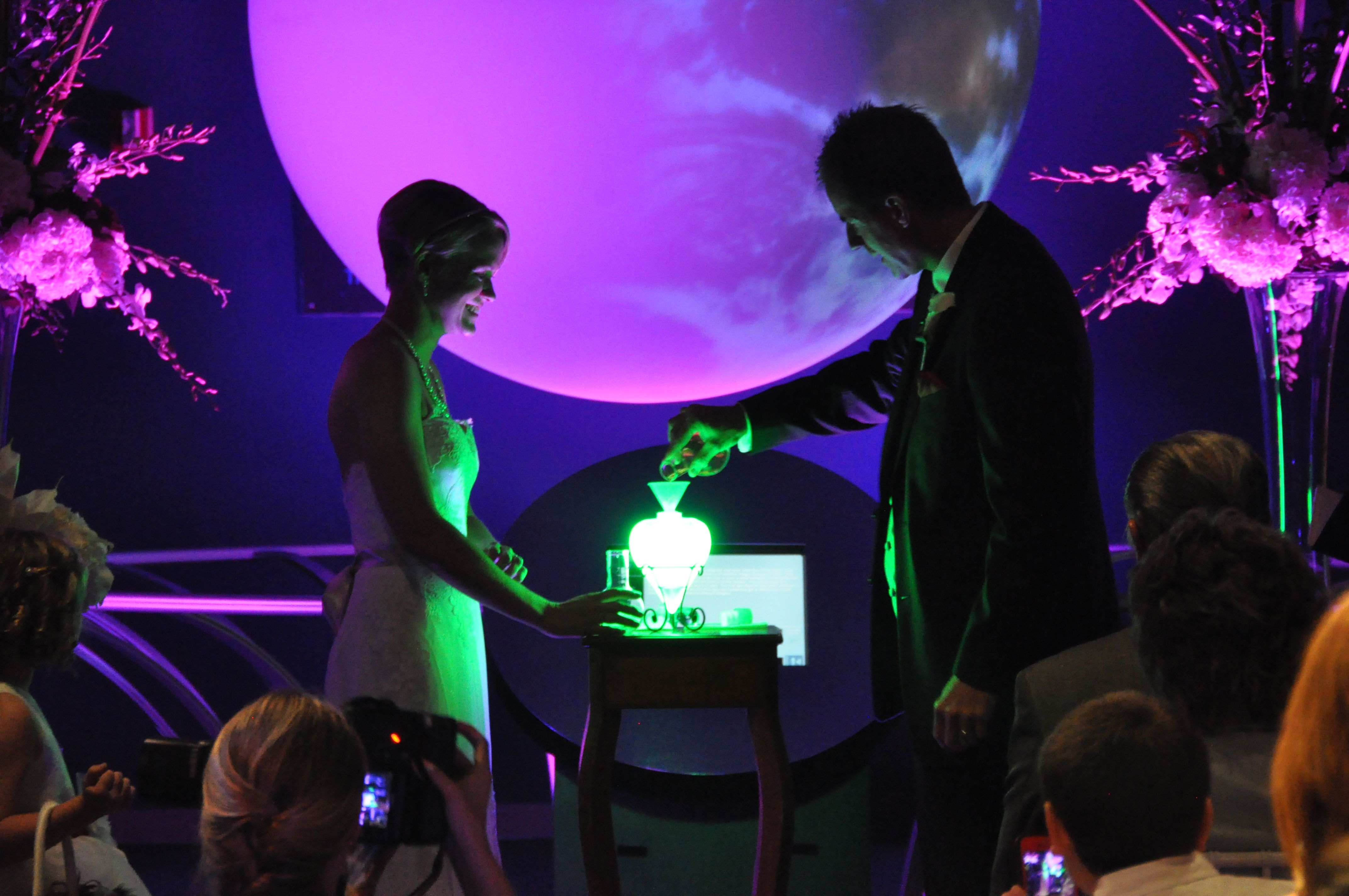 average price for wedding dj in new jersey%0A Our Planet Our Universe exhibit wedding ceremony at Orlando Science Center   Uplighting and photograph by
