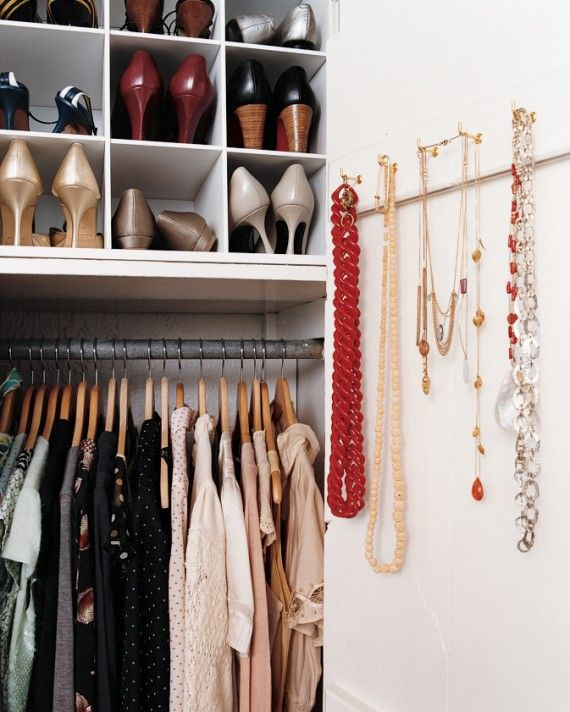 Simple shoulder hooks in the inside of the closet can hold necklaces -- the clutter of jewelry on a bedside table can make the bedroom feel overwhelming. And as for the shoes, they can stand proudly (and neatly) in two sturdy wooden organizers.
