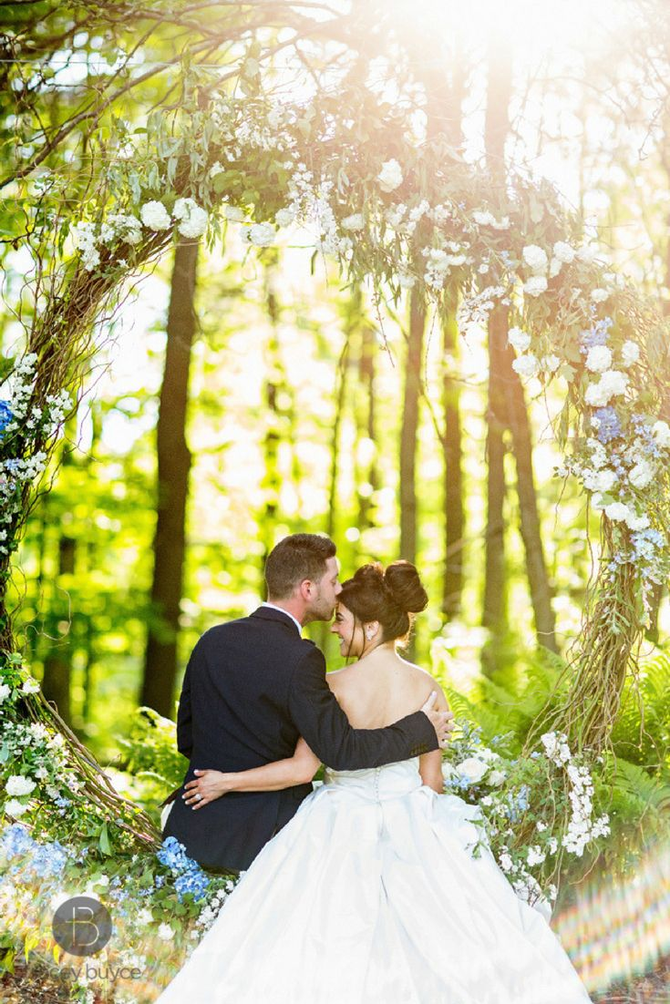 Bride And Groom Share A Sweet Kiss On Wedding Flowers Swing In
