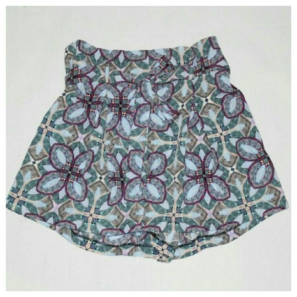 "Socialite ""PAPER BAG WAIST"" Geometric Skort NWOT - Socialite brand Geometric , Skort Style Shorts, Size Large.  Amazing geometric print is rich in beautiful blue, purple, soft yellow, and green. The skort is actually extra extra flowy wide legs constructed in a way that creates the illusion that you are wearing a skirt! SCORE! Right?!  So you truly get the best of both worlds!  The material is soft, light, and nice against the skin! Socialite Skirts Mini"