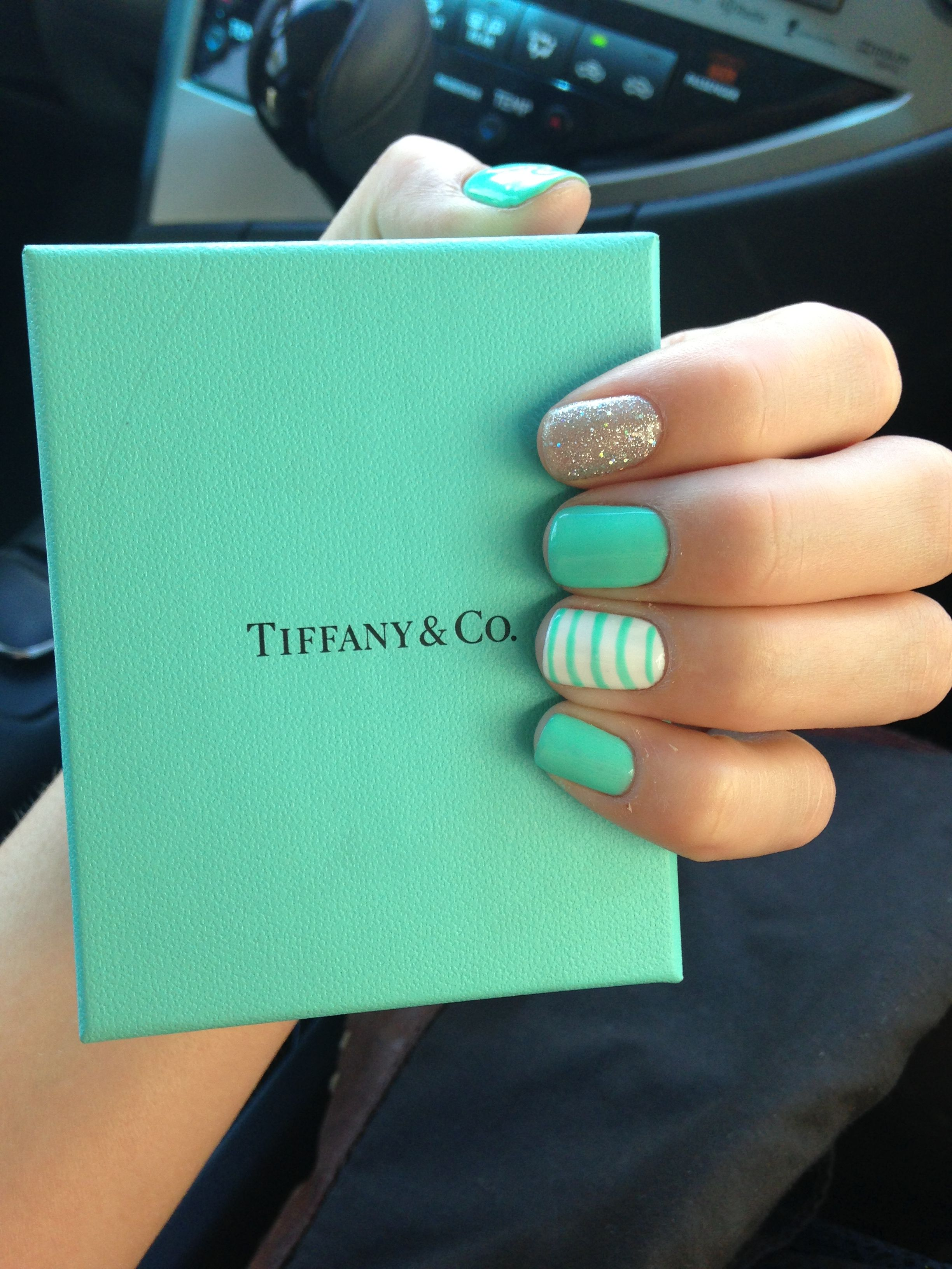Mint green nails, maybe with tips dipped in gold glitter??
