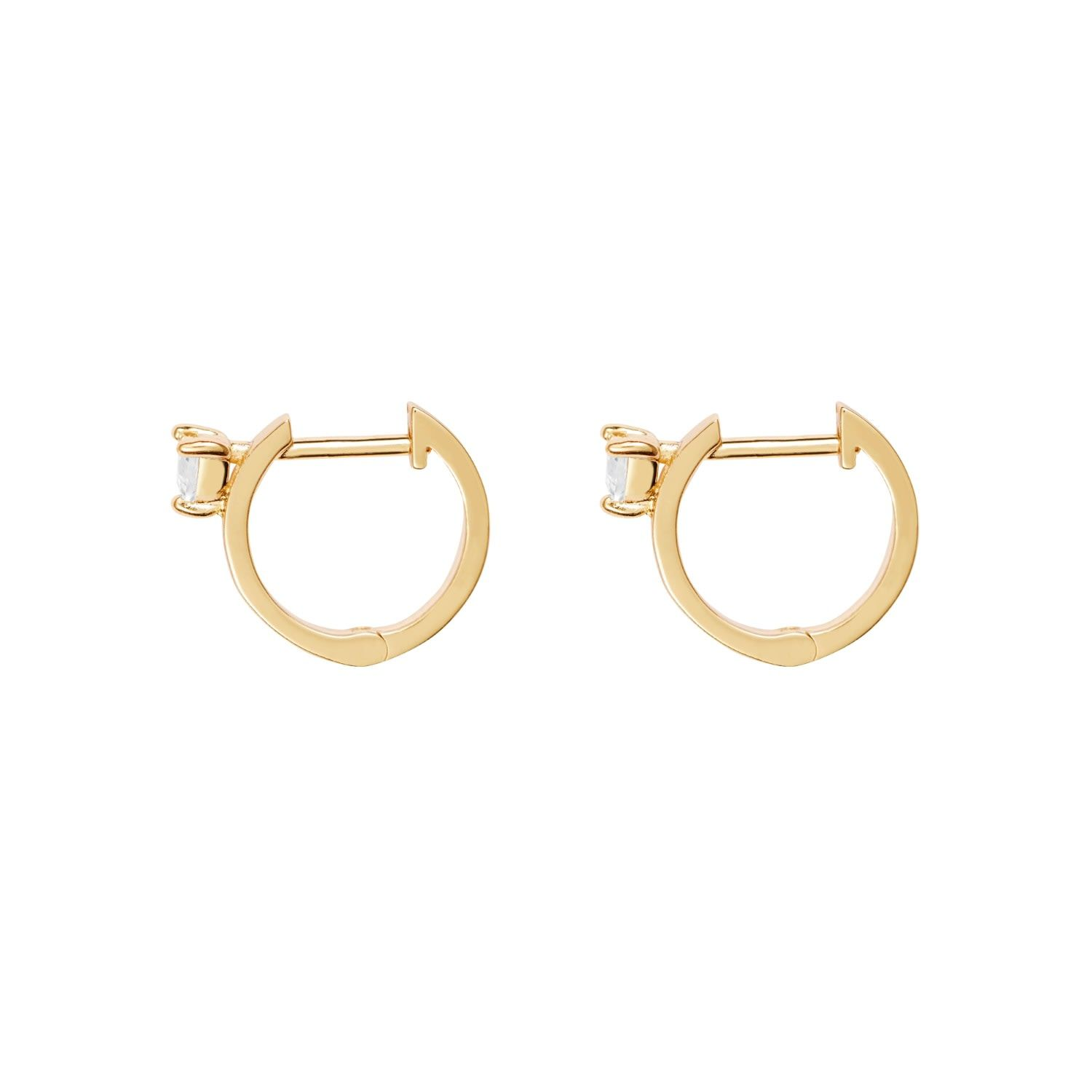 Our fan favorite huggie earrings get a luxe update with the Heart Space Earrings. Shine a light on these gold gilt huggie earrings studded with a single cubic zirconia crystal on each side. - Brass - Nickel free - 14K gold plating - Cubic zirconia stones - Hinge closure earrings - 925 sterling silver posts Every jewel deserves a little loving and care! Always avoid contact with chemicals and moisture' such as hair spray, perfume' lotions' household cleansers, pool and sea water. You can help avo