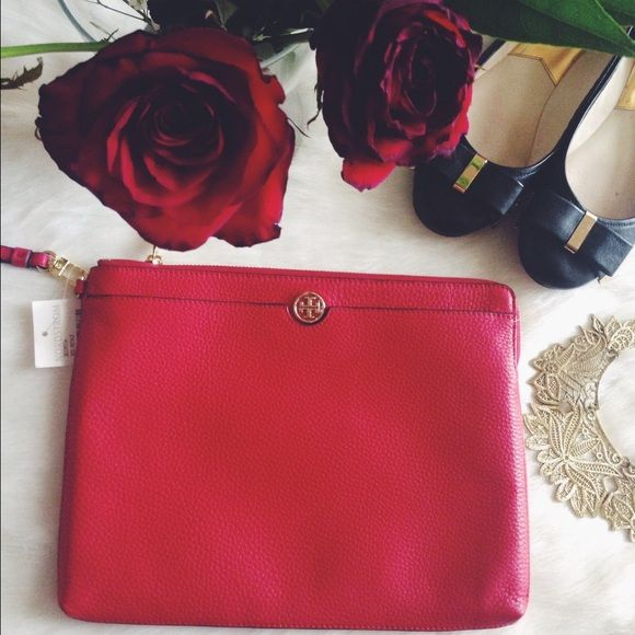 Tory Burch Wristlet NWT TORY BURCH Roslyn Leather Red Kir Royale Kir  Color Code Kir Royale/ 600 Kir Royale / Red Leather with the Tory Burch Double T Logo On the Front Of the Bag  Zip Top and Side Closure  Removable Wrist Strap Interior Has Red Fabric Interior with Leather Trim Interior Has 2 Slip Pockets and one Zip  Approx Measurements: 7.0'' Long x 5.0'' High x .5'' Deep Tory Burch Bags Clutches & Wristlets