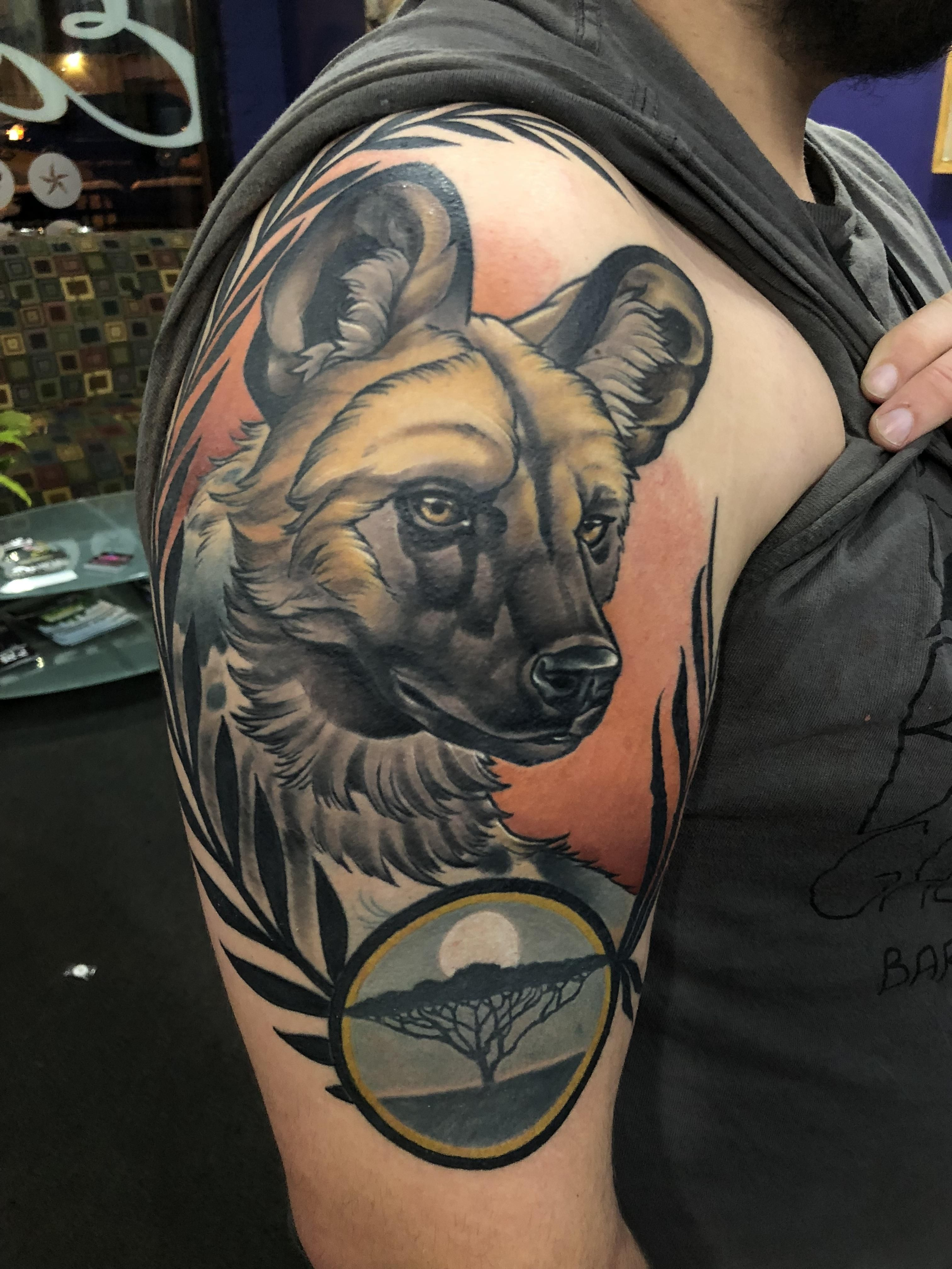African Wild Dog By James Hurley At Eclectic Tattoo Shop In East Lansing Michigan African Wild Dog African Tattoo Africa Tattoos
