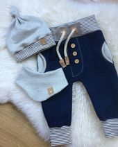 Photo of Baby boy boy sew pants, material fabric mix combination, bags, ribbon cord, buttons, button, …