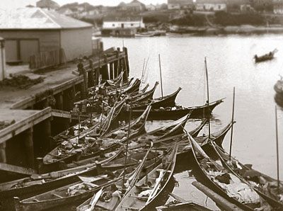 This Is A Black And White Photograph Of First Nations Canoes At Wharf In Victoria
