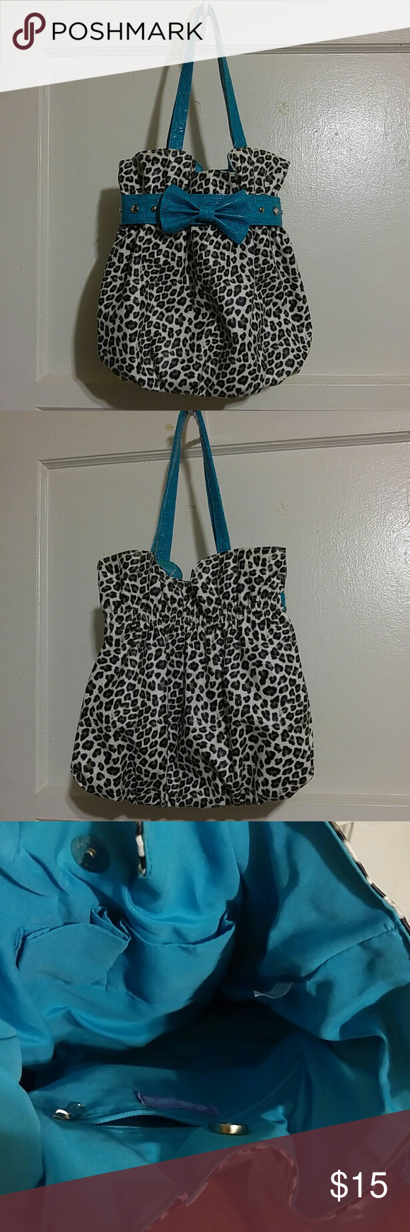 CUTE Leopard Black n White Purse Black n white leopard cinched purse with a turquoise bow and trim. Also has 2 diamond studs and 2 silver studs. In excellent condition. Claire's Bags Shoulder Bags