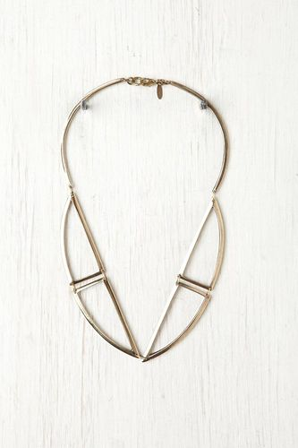 Annie Costello Brown Bentuk Necklace - this streamlined and structured necklace combines geometry and nature to create a stunning accessory for summer. Part warrior, part princess, the golden shapes look like two birds in flight, their wide-spread wings a symbol of freedom and adventure. This piece makes a strong yet soft-spoken statement. #r29summerstyle