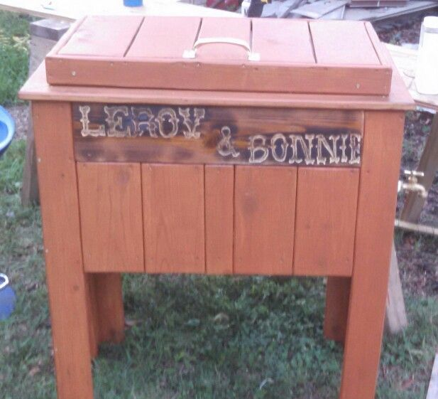 Wood cooler with carving