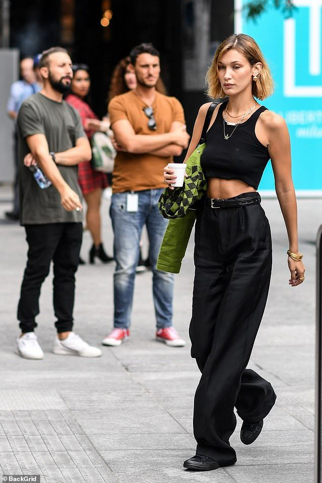 Photo of Bella Hadid flashes her toned tummy in a crop top in Milan