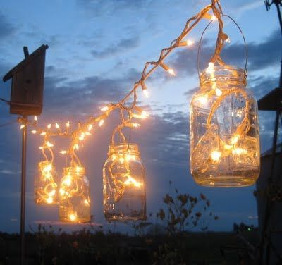 My favorite idea is using mason jars and a basic string of white Christmas lights to create fun outdoor lighting. What a beautiful decorating idea for a backyard picnic with friends.
