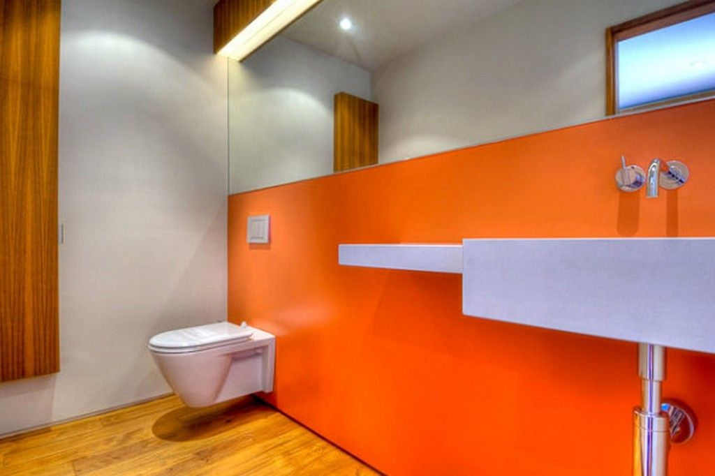 Neon Orange Bathroom Wall Accents Decoration With Tank Less White Wall Hung Toilet And Concrete Floating
