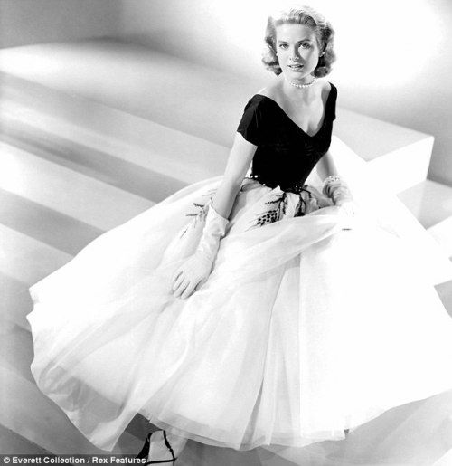Grace Kelly wearing a dress designed by Edith Head for her first scene in Hitchcock's Rear Window (1954).