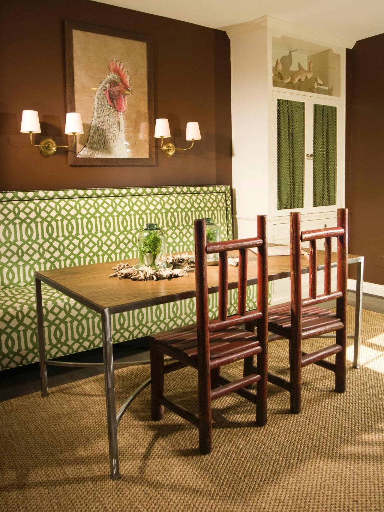 This Dining Area Features A Green Upholstered Banquette, A Table