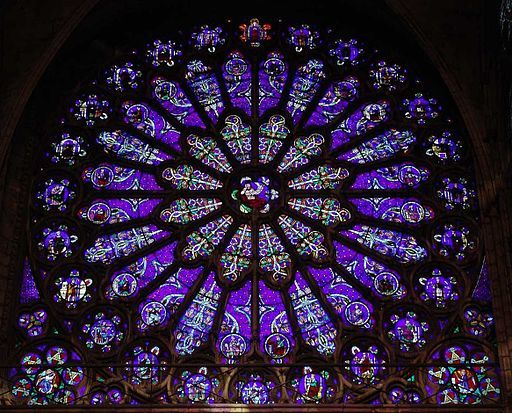"The Basilica of St Denis, Paris, France: South transept Rose window, subject: Jesse Tree (Ancestors of Christ). Art Nouveau style.     WOW! What a window!  Amazing colour--mauve, I think it is.  Anyways, purplish blue.  A deep, meditative colour, ideal for a mandala, which is what ""rose windows"" are, in effect."