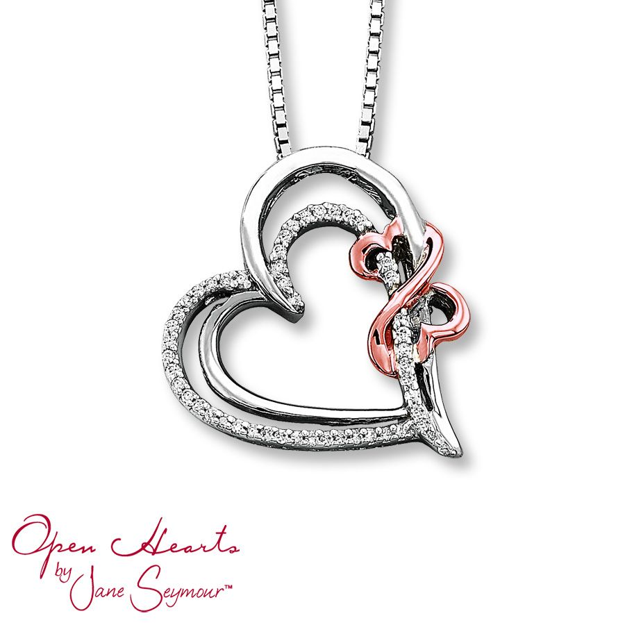 This fine jewelry necklace features two beating heartsone awash