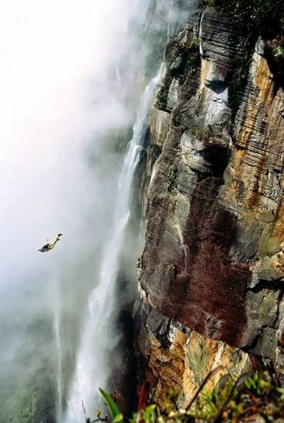 Man BASE jumping off Angel Falls, Venezuela Photo by Ken Fisher on Getty Images...