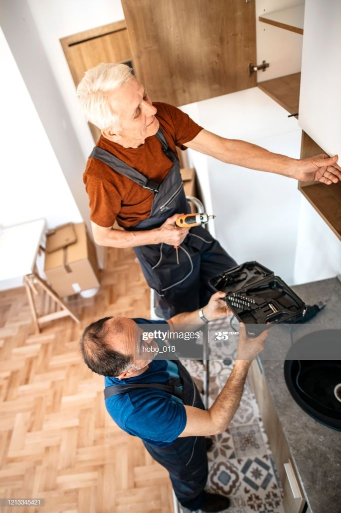 Two Senior Handymen Assembling Kitchen Furniture Photography #Ad, , #affiliate, #Assembling, #Handymen, #Senior, #Photography