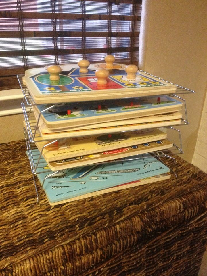 Instead of purchasing a puzzle rack, use stackable cooling racks to  organize your child's puzzles