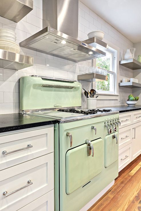 incredible white kitchen cabinets black appliances | Incredible kitchen with mint green enamel stove flanked by ...