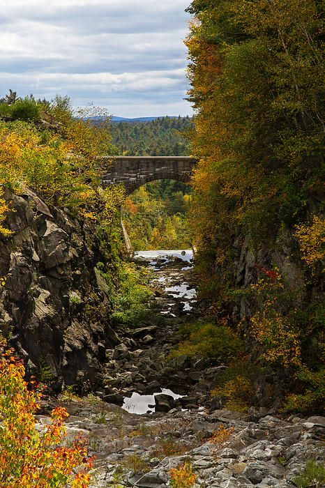 Winsor Dam Bridge: The stone bridge over the spillway and fall foliage at Winsor Dam at Quabbin Reservoir in Massachusetts.  Photo by Art Dodd