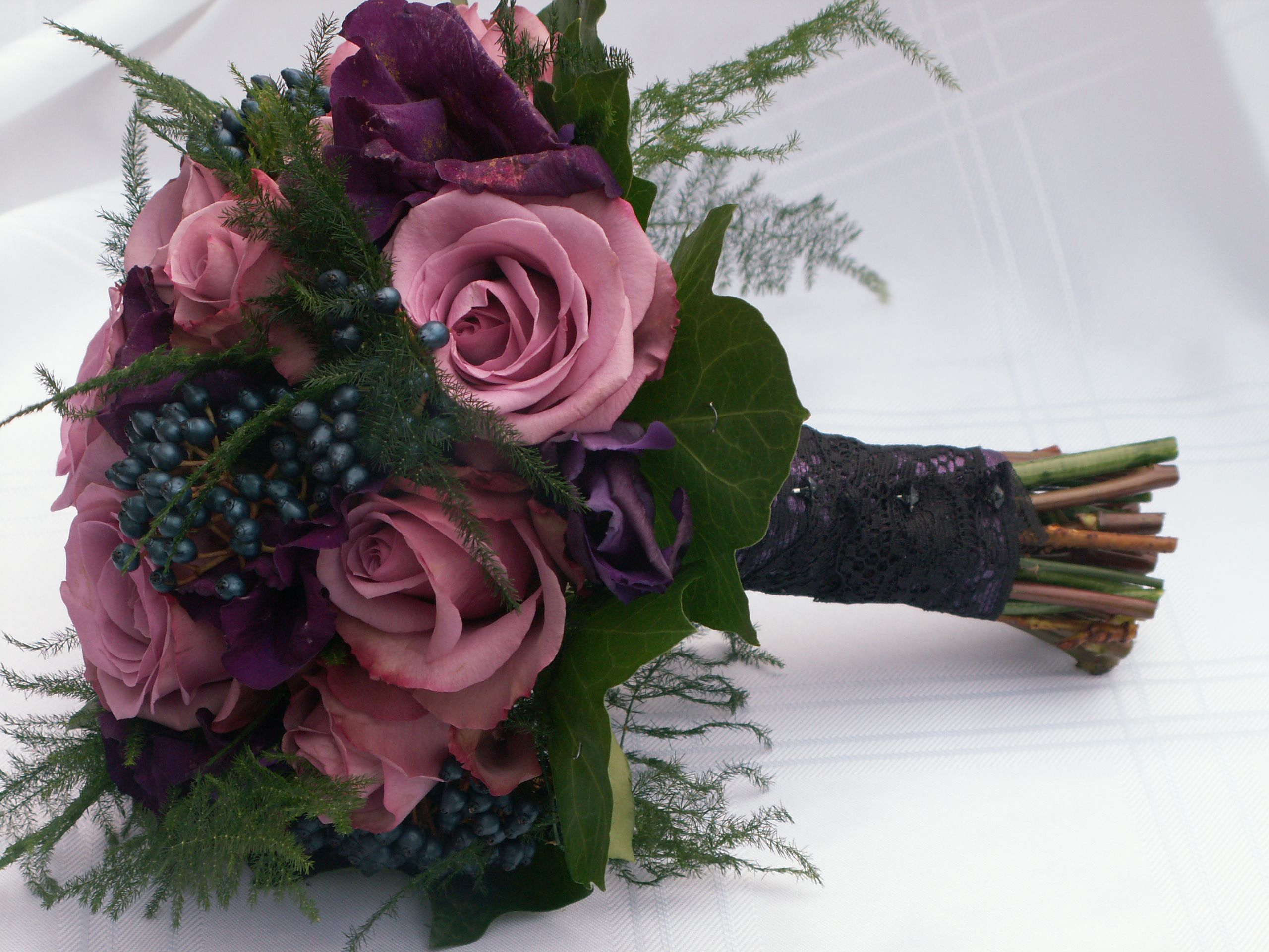Dusky Pink Roses Purple Lisianthus And Steel Berries For A Gothic