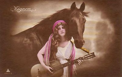 Gypsy girl with horse and guitar.